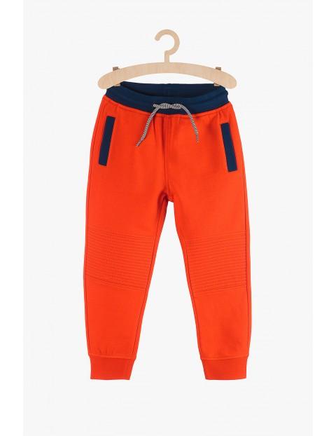 Dresowe spodnie chłopięce- pomarańczowe