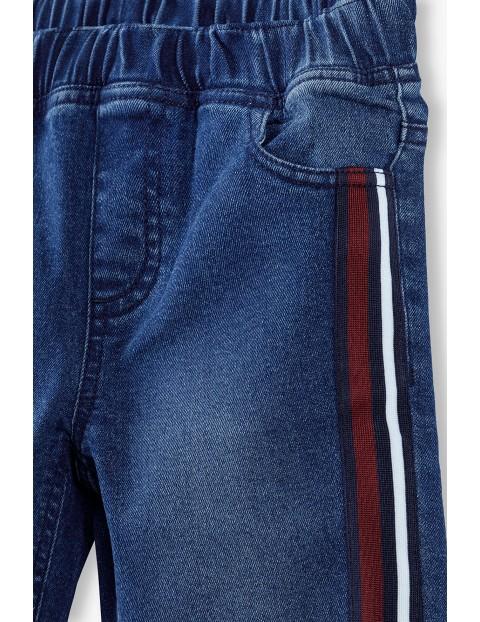 Granatowe spodnie dziewczęce z lampasami