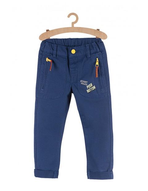 Spodnie dla chłopca-granatowe z nadrukami