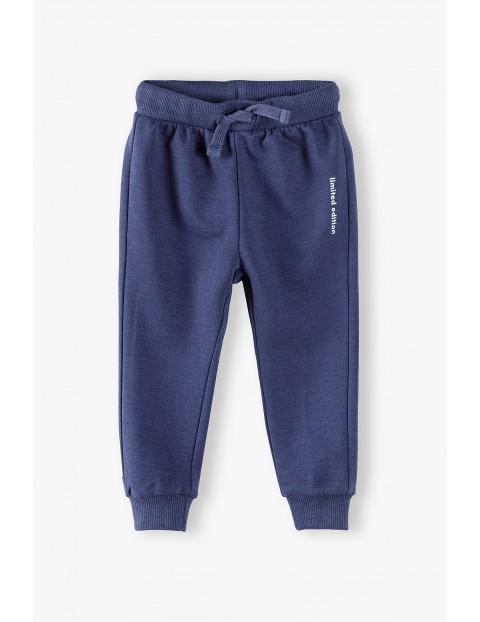 Spodnie dresowe niemowlęce - granatowe Limited Edition