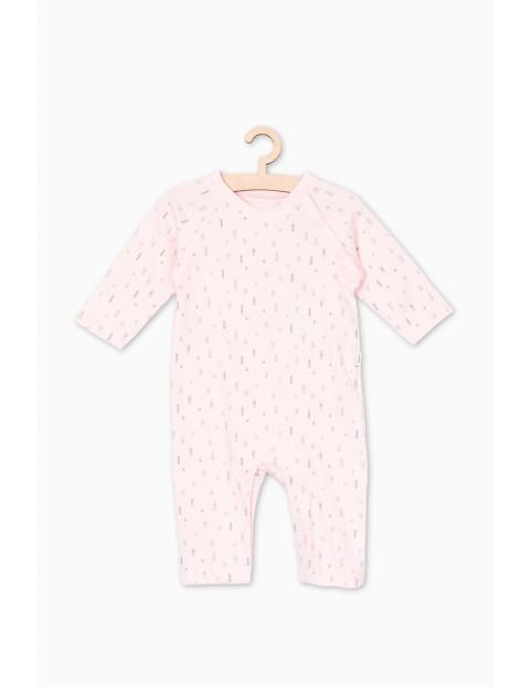 Różowy pajac dla niemowlaka