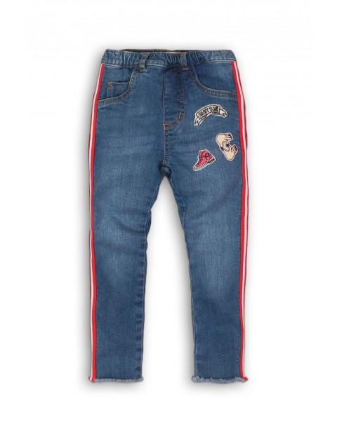 Spodnie dziewczęce jeansowe z naszywkami i lampasami