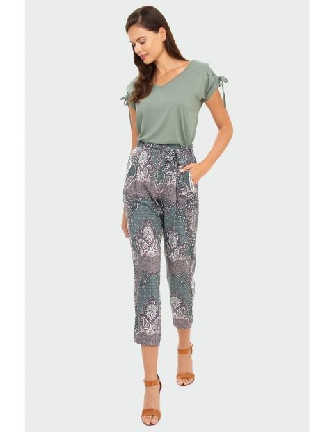Spodnie damskie z ozdobnym wiązaniem - 7/8 nogawka
