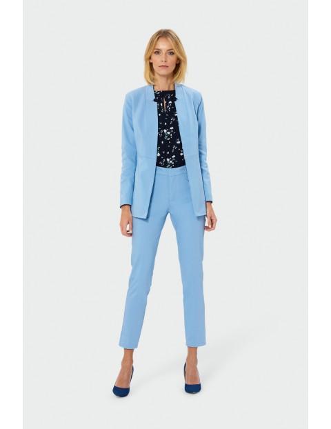 Spodnie cygaretki z imitacją kieszeni i zamkiem z pliską