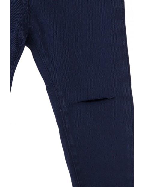 Spodnie dziewczęce granatowe z rozcięciami na kolanach