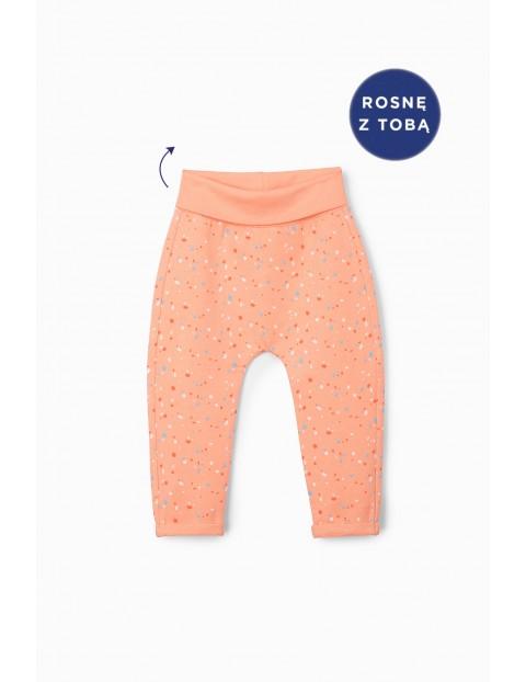 Spodnie niemowlęce we wzorki - pomarańczowe