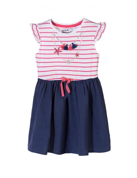 908edfe757 Bawełniana sukienka dla dziewczynki z ozdobnymi nadrukami