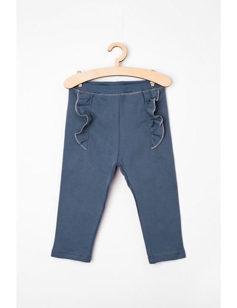 Spodnie niemowlęce dzianinowe z falbankami