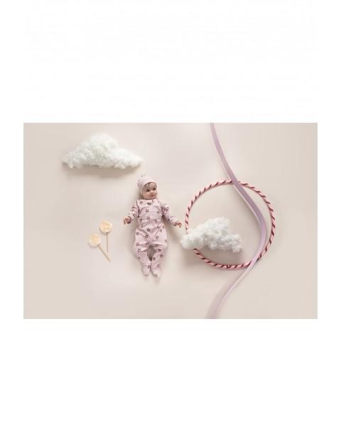 Pajac niemowlęcy różowy w kwiatki