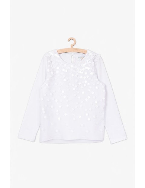 Biała bluzka z połyskującymi cekinami