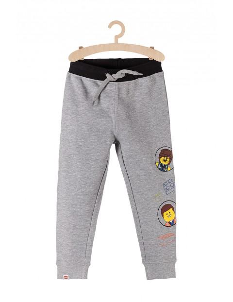 Dresowe spodnie dla chłopca z nadrukami Lego