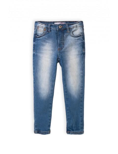 Spodnie dziewczęce jeansowe z wybarwieniami- niebieskie