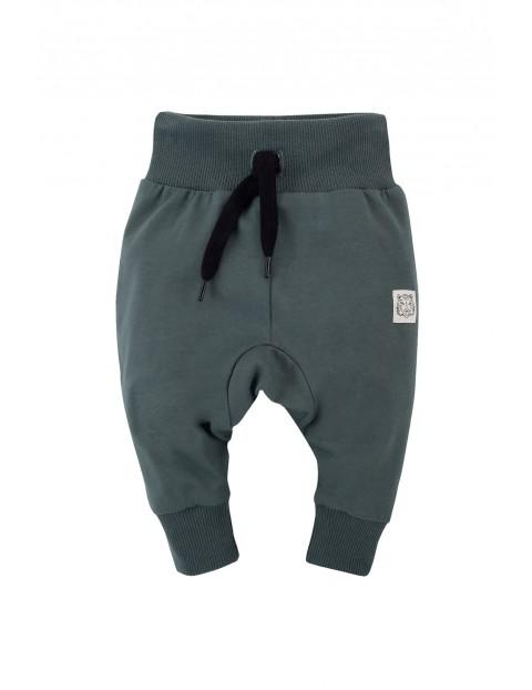 Bawełniane spodnie dresowe niemowlęce - zielone
