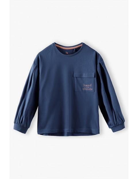 Bawełniana niebieska bluzka dziewczęca z kieszonką i bufiastymi rękawami
