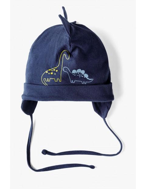 Granatowa wiązana pod szyją czapka dla niemowlaka