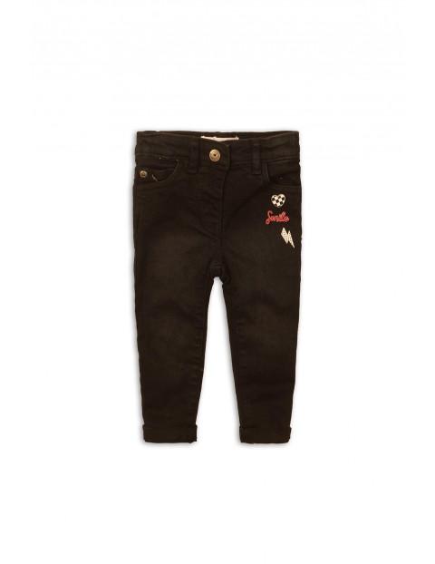Czarne spodnie niemowlęce z naszywkami