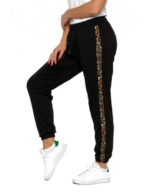 Spodnie damskie dresowe czarne z lampasem