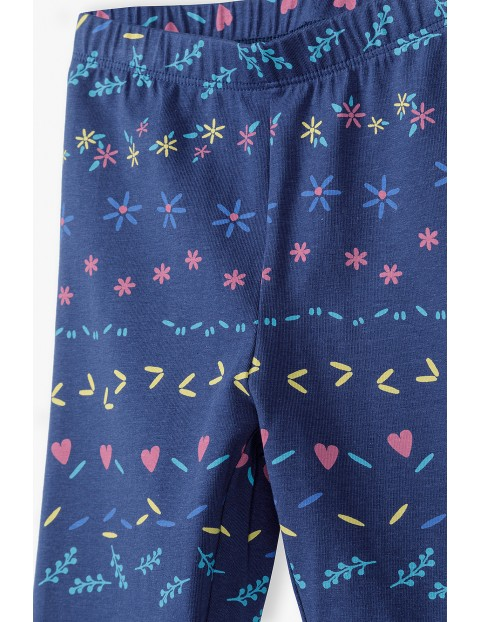 Granatowe legginsy dziewczęce w kolorowe wzorki