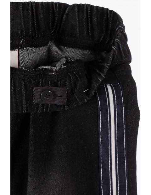 Jeeginsy dziewczęce czarne z lampasami