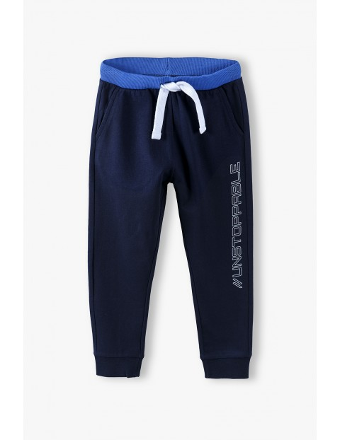 Spodnie dresowe chłopięce w kolorze granatowym
