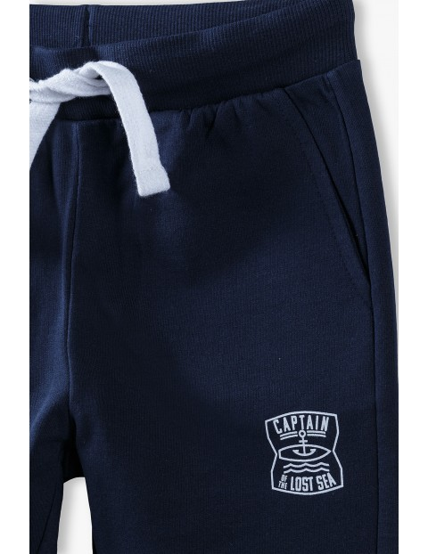 Spodnie dresowe chłopięce granatowe