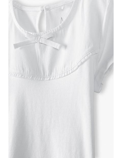 Biały t -shirt dziewczęcy z ozdobną kokardką
