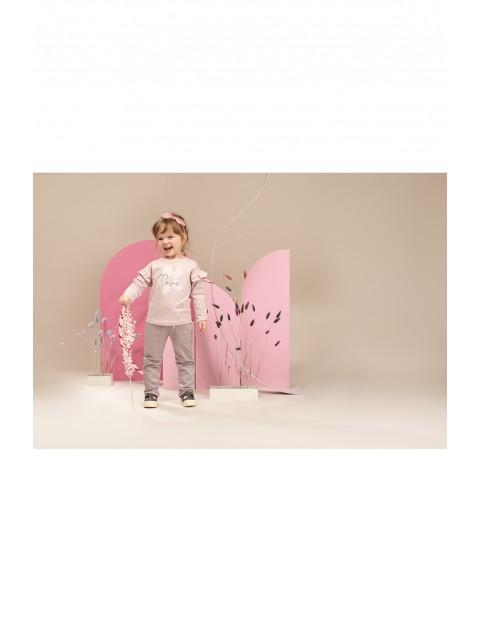 Bluzka dziewczęca z długim rękawem z falbanką różowa