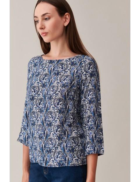 Wzorzysta bluzka damska z ozdobnym wiązaniem na boku