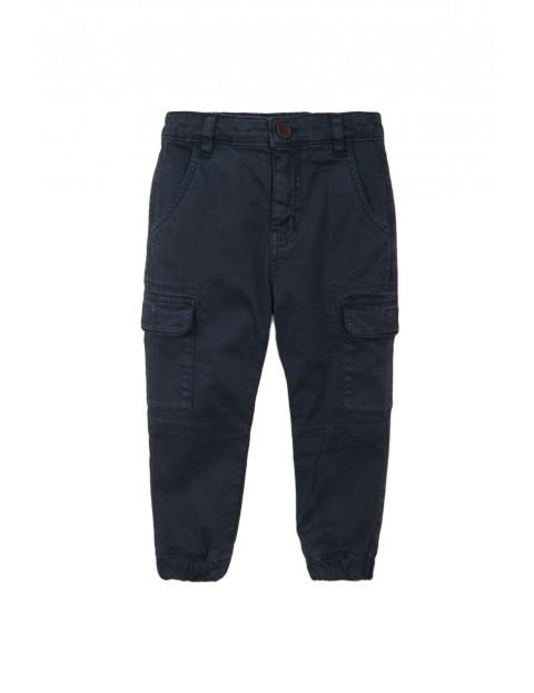 Spodnie chłopięce tkaninowe- granatowe z kieszeniami rozm 92/98