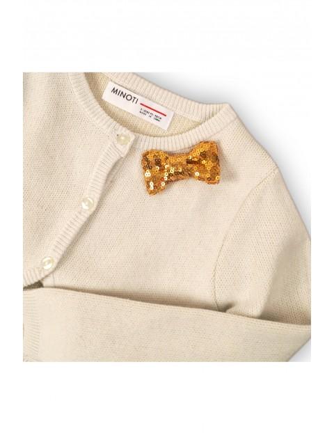 Sweter dziewczęcy z cekinową kokardką