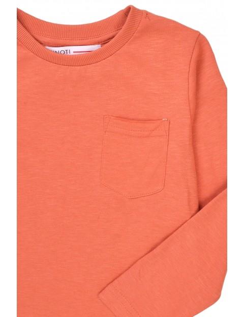 Pomarańczowa bluzka niemowlęca z kieszonką