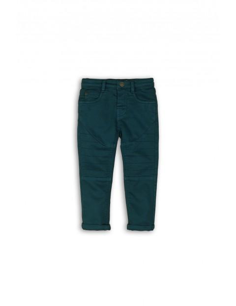 Spodnie z motocyklowymi przeszyciami- niebieskie rozm 92/98