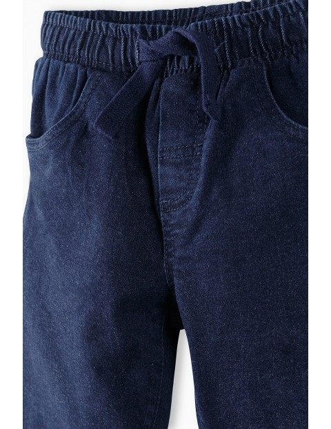 Spodnie chłopięce jeansowe w kolorze granatowymn