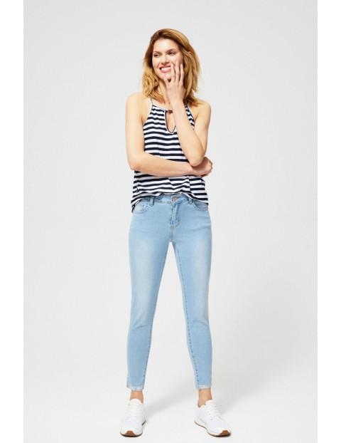 Jeansy damskie z metalicznym zdobieniem - niebieskie slim