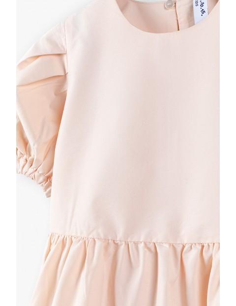 Sukienka na krótki rękaw z falbankowym dołem - różowa