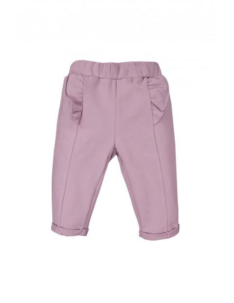 Bawełniane spodnie niemowlęce - wrzosowe