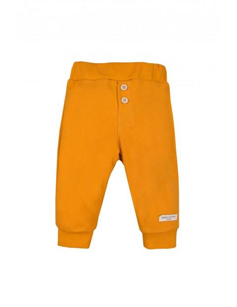 Bawełniane spodnie z kieszonką - miodowe