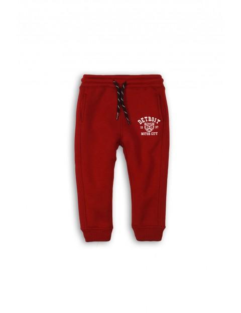 Spodnie dresowe z kieszeniami - bordowe rozm 92/98