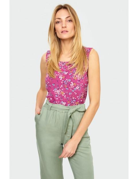 Zielone spodnie damskie z ozdobnym wiązaniem - 3/4 nogawka