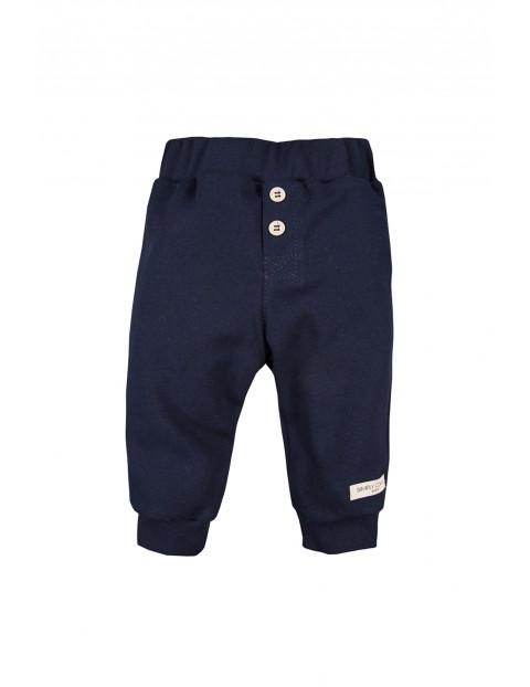Bawełniane spodnie z kieszonką SIMPLY COMFY -  granatowe