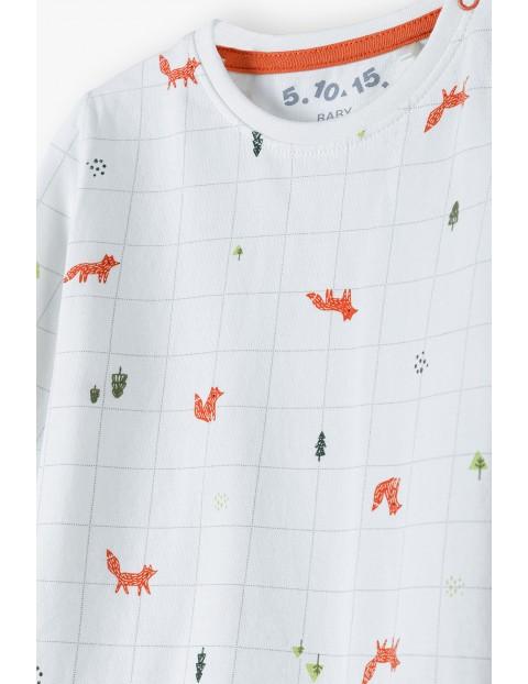 Bawełniana bluzka niemowlęca z długim rękawem - biała w liski