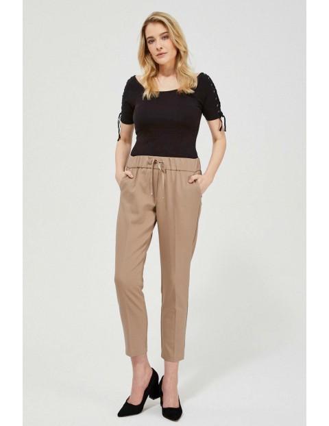 Spodnie damskie w kant - brązowe