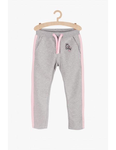 Szare dresowe spodnie dla dziewczynki- różowe wstawki