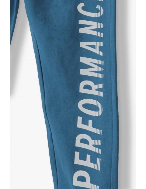 Bawełniane spodnie dresowe chłopięce w kolorze niebieskim- Performance
