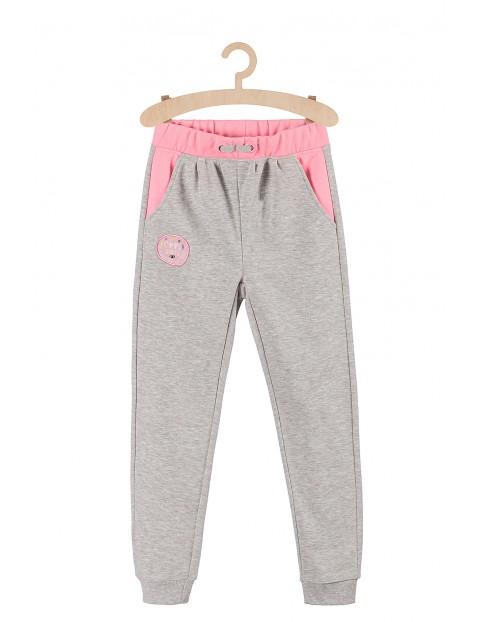 Dresowe spodnie dla dziewczynki- szare z różowymi wstawkami