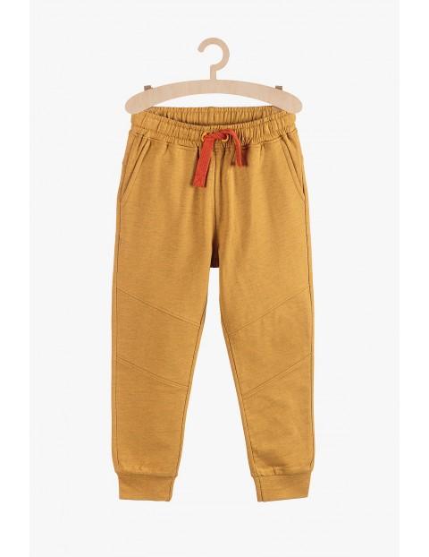 Dresowe spodnie dla chłopca- motocyklowe przeszycia