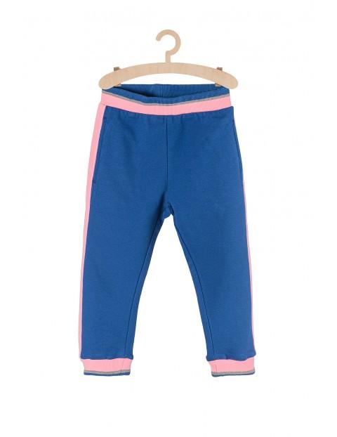 Spodnie dresowe dla dziewczynki niebieskie z różowymi lampasami