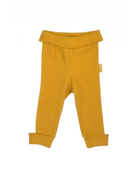 Spodnie dziewczęce dresowe w musztardowym kolorze