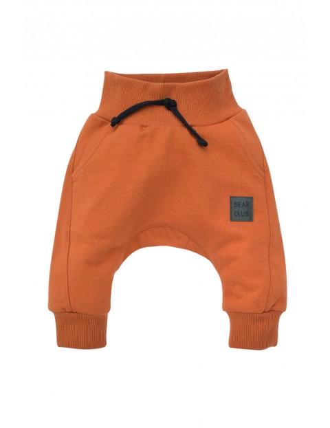 Spodnie niemowlęce pomarańczowe Bears Club