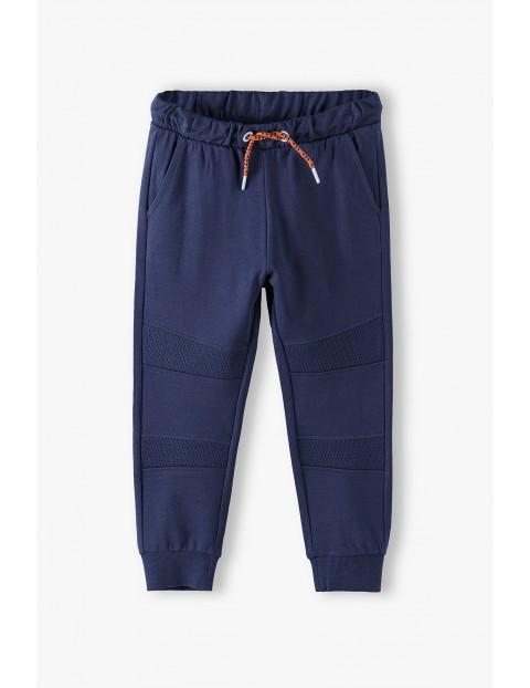 Bawełniane spodnie dresowe chłopięce- granatowe